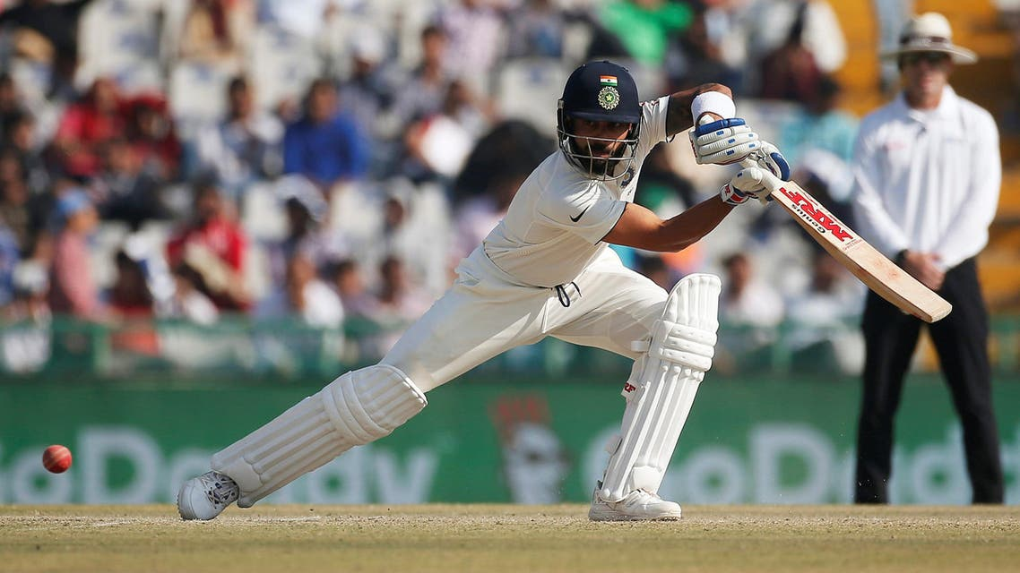India's Virat Kohli plays a shot against England on the second day of the third test in Mohali, India. (Reuters)