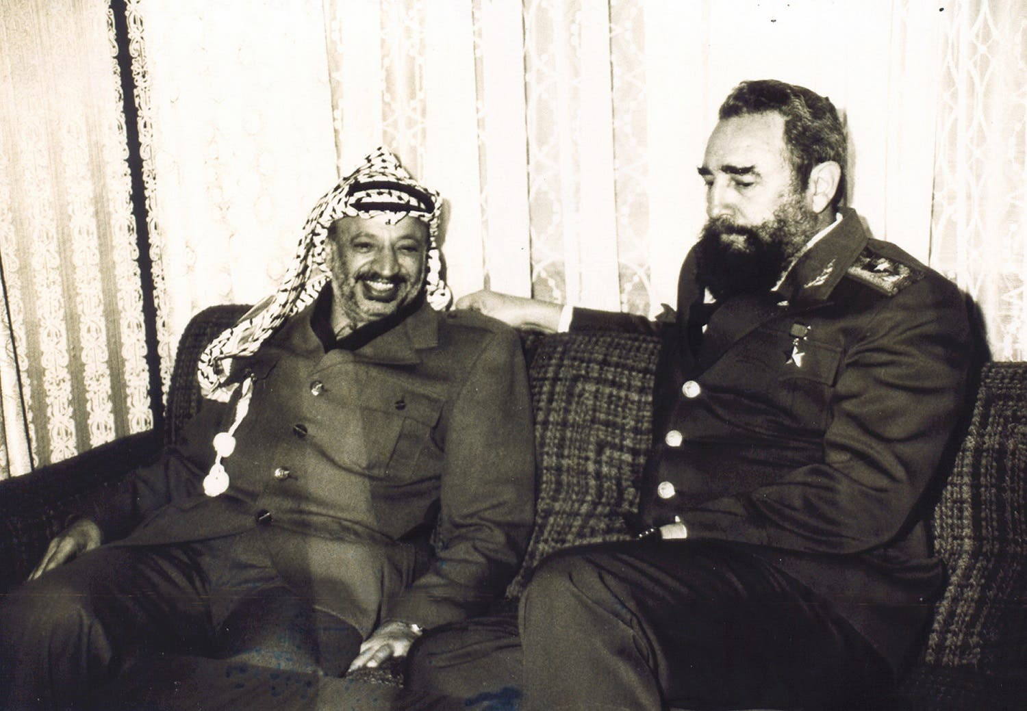 This is an undated file photograph of Palestinian leader Yasser Arafat, left, and Cuban Pesident Fidel Castro, made available by the Palestinian Authority in Gaza City of the Gaza Strip. (AP Photo/Palestinian Authority)