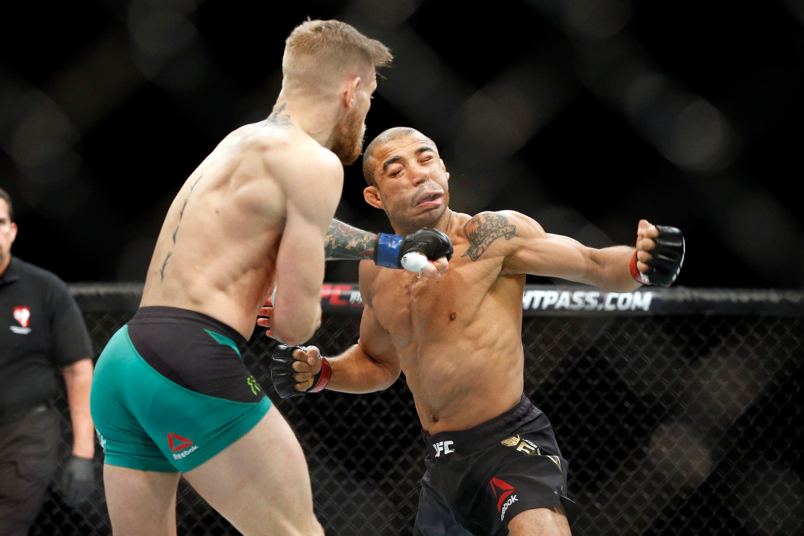 Conor McGregor knocks out Jose Aldo during a featherweight championship mixed martial arts bout at UFC 194, Saturday, Dec. 12, 2015, in Las Vegas. (AP)