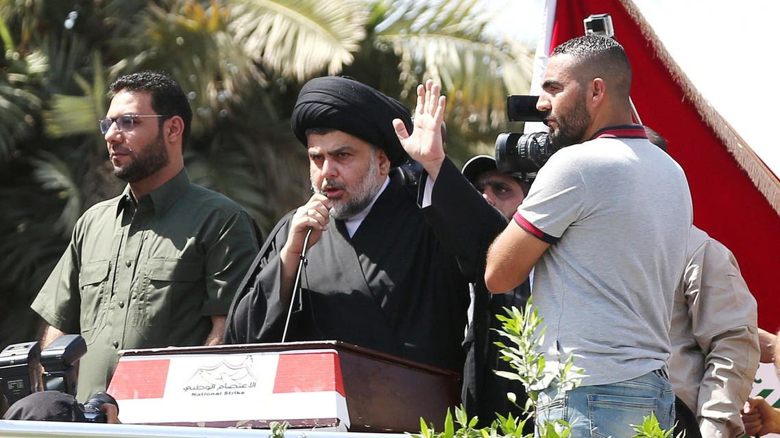 Iraq's Shiite cleric Muqtada al-Sadr, center, speaks to his followers demonstrating at Tahrir Square in Baghdad, Iraq, Friday, July 15, 2016. Tens of thousands of supporters of the powerful Iraqi Shiite cleric have rallied in central Baghdad to press demands for reform and an end to alleged corruption in the government. (AP)
