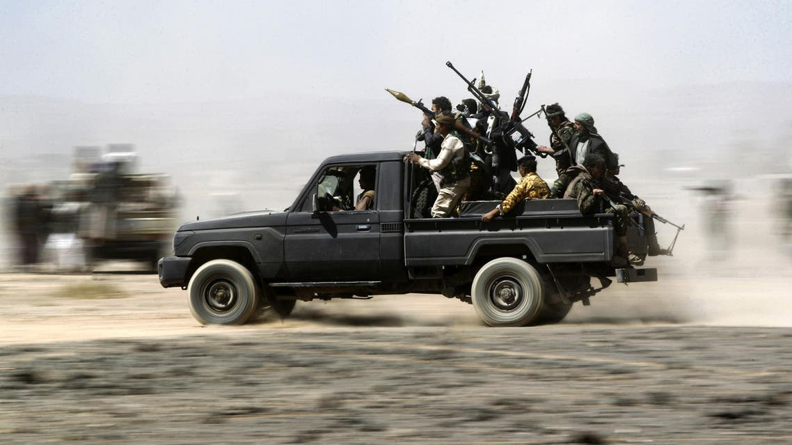 Armed Yemeni tribesmen loyal to the Shiite Huthi rebels sit in the back of an armed vehicle during a gathering to mobilise more fighters into several battlefronts on November 1, 2016 on the outskirts of the capital Sanaa. The war in Yemen escalated in March 2015 when the Saudi-led coalition launched a military campaign to push back the Huthi rebels, after they seized the capital in 2014 and then advanced on other parts of Yemen.   MOHAMMED HUWAIS / AFP