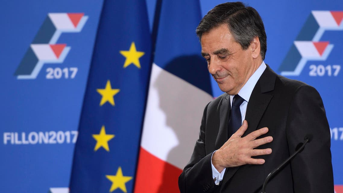 French member of Parliament and candidate for the right-wing primaries ahead of France's 2017 presidential elections, Francois Fillon gestures as he delivers a speech following the first results of the primary's second round on November 27, 2016, at his campaign headquarters in Paris. France's conservatives held final run-off round of a primary battle on November 27 to determine who will be the right wing nominee for next year's presidential election. ERIC FEFERBERG / AFP