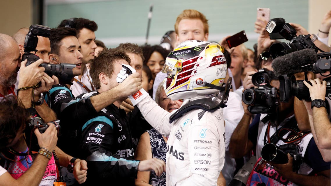 Mercedes' Formula One driver Lewis Hamilton of Britain celebrates after winning the race. REUTERS