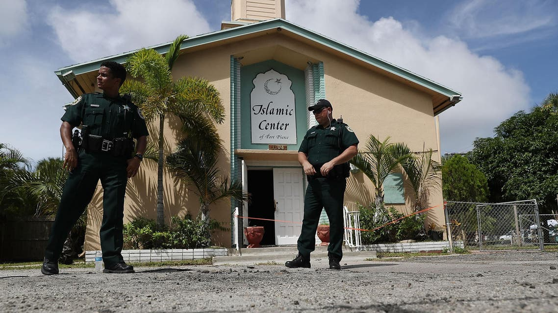 FORT PIERCE, FL - SEPTEMBER 12: Law enforcement officials investigate a fire at the Islamic Center of Fort Pierce, which was the mosque attended by the Pulse nightclub gunman, who killed 49 people in Orlando on September 12, 2016 in Fort Pierce, Florida. Law enforcement officials are investigating the fire as an arson and say that surveillance cameras show a person approaching the mosque moments before the blaze on Monday morning. Joe Raedle/Getty Images/AFP  JOE RAEDLE / GETTY IMAGES NORTH AMERICA / AFP