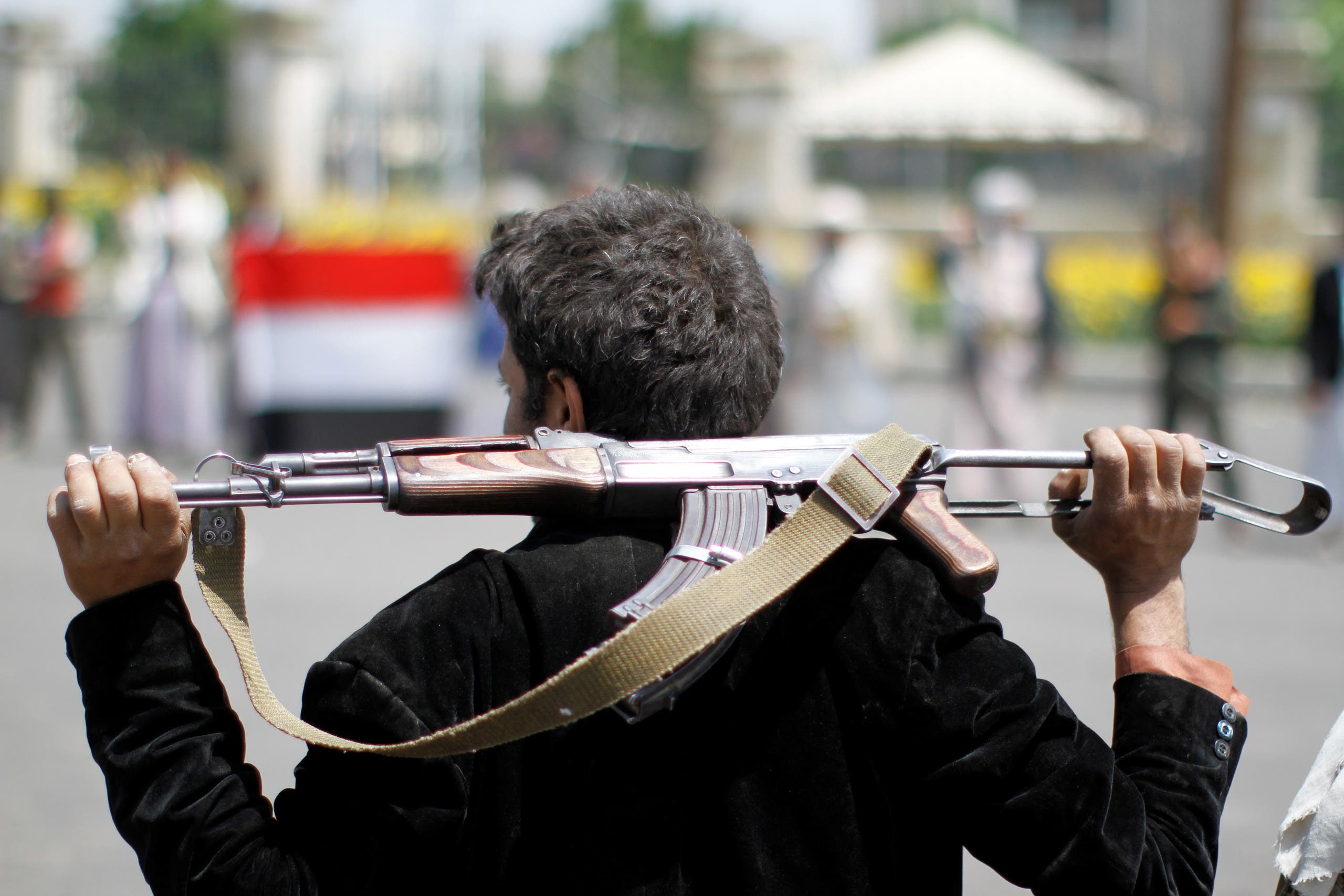 An armed man loyal to the Houthi movement holds his weapon as he gathers to protest against the Saudi-backed exiled government deciding to cut off the Yemeni central bank from the outside world, in the capital Sanaa, Yemen August 25, 2016. REUTERS/