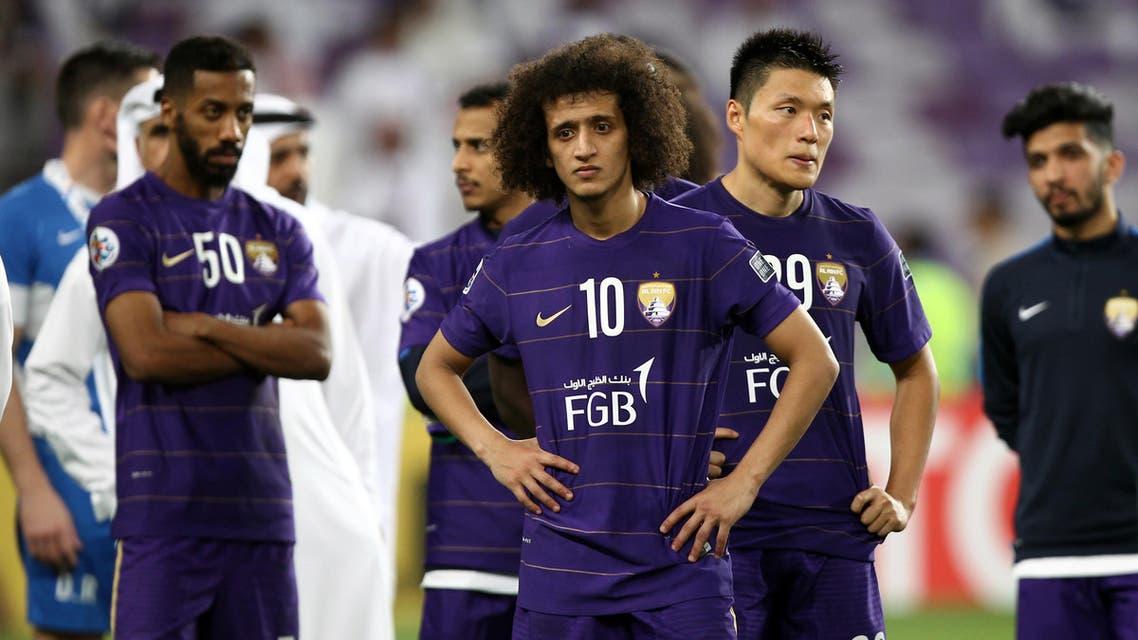 Al-Ain's midfielder Omar Abdulrahman (C) and teammates react after losing during their AFC Champions League final between UAE's Al-Ain and South Korea's Jeonbuk Hyundai Motors at the Hazza bin Zayed Stadium in Al-Ain on November 26, 2016.  (AFP)
