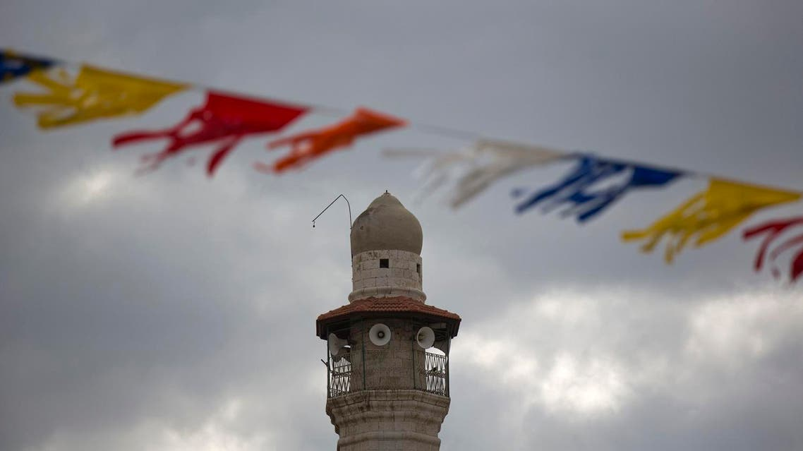 The minaret of a mosque is seen in Lod, a mixed Jewish Muslim and Christian city in central Israel, Wednesday, Nov. 16, 2016 (Photo: AP/Ariel Schalit)