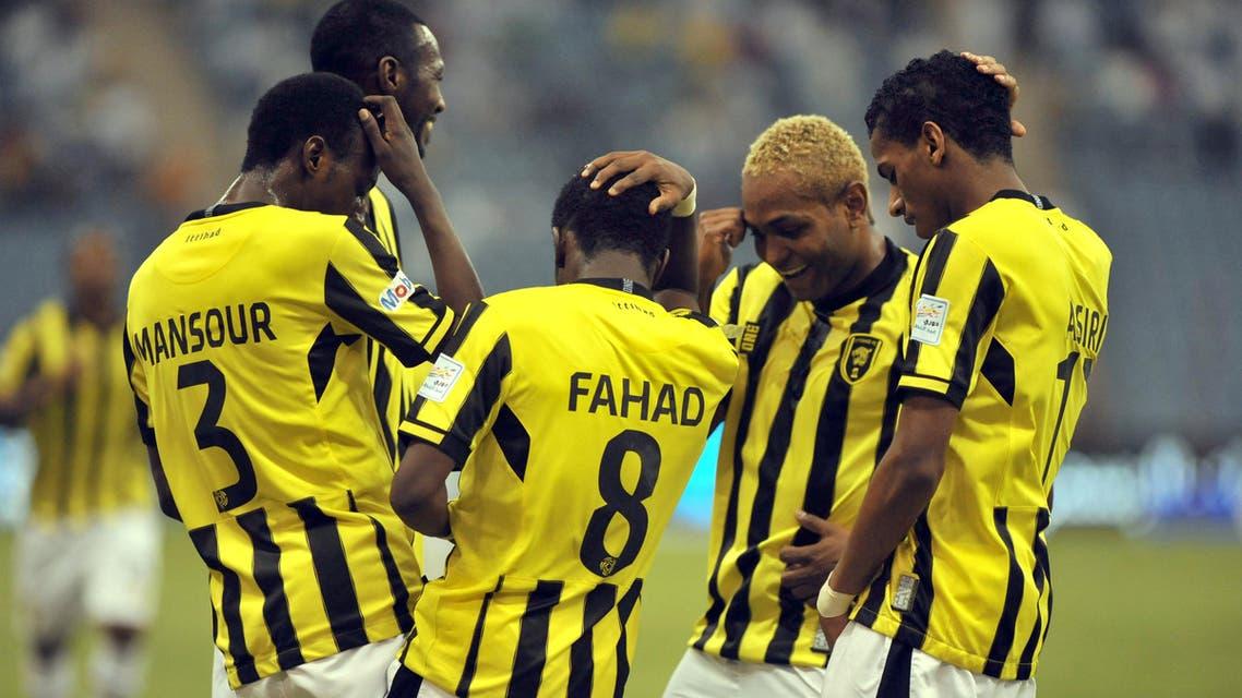 Saudi Al Ittihad's players celebrate after scoring against Al-Hilal's team during their Saudi Professional League football match at the King Fahad stadium in the capital of Riyadh, on September 20, 2013. AFP PHOTO/FAYEZ NURELDINE