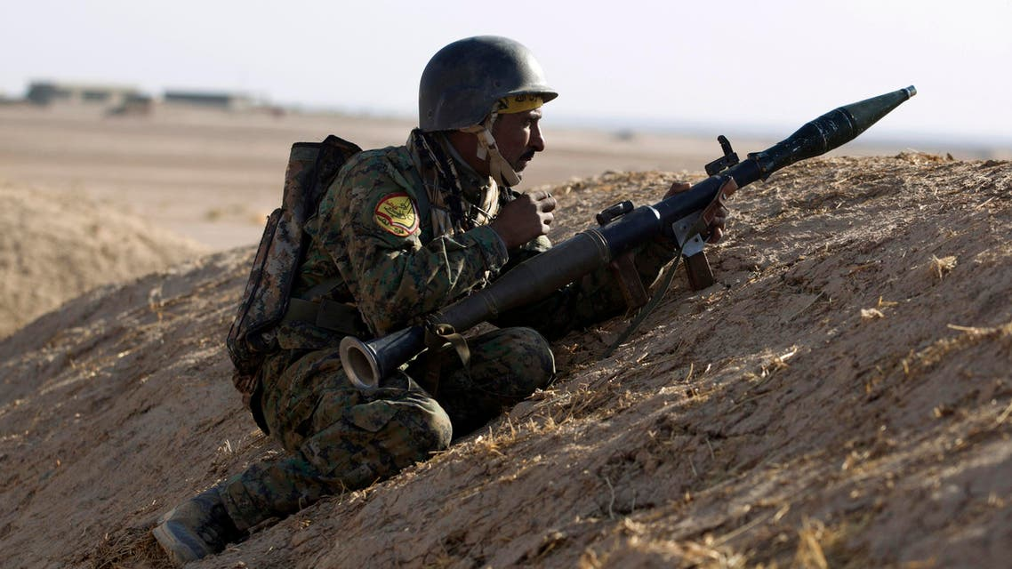 An Iraqi Shiite fighter from the Hashed al-Shaabi (Popular Mobilisation) paramilitaries keeps position as fighters advance near the village of Tal Faris, south of Tal Afar, on November 29, 2016 during a broad offensive by Iraq forces to retake the city Mosul from jihadists of the Islamic State group. The Hashed al-Shaabi (Popular Mobilisation) paramilitaries have reached the outskirts of the town of Tal Afar, west of Mosul, and are moving eastward. They said they retook more than 12 villages over the past four days AHMAD AL-RUBAYE / AFP