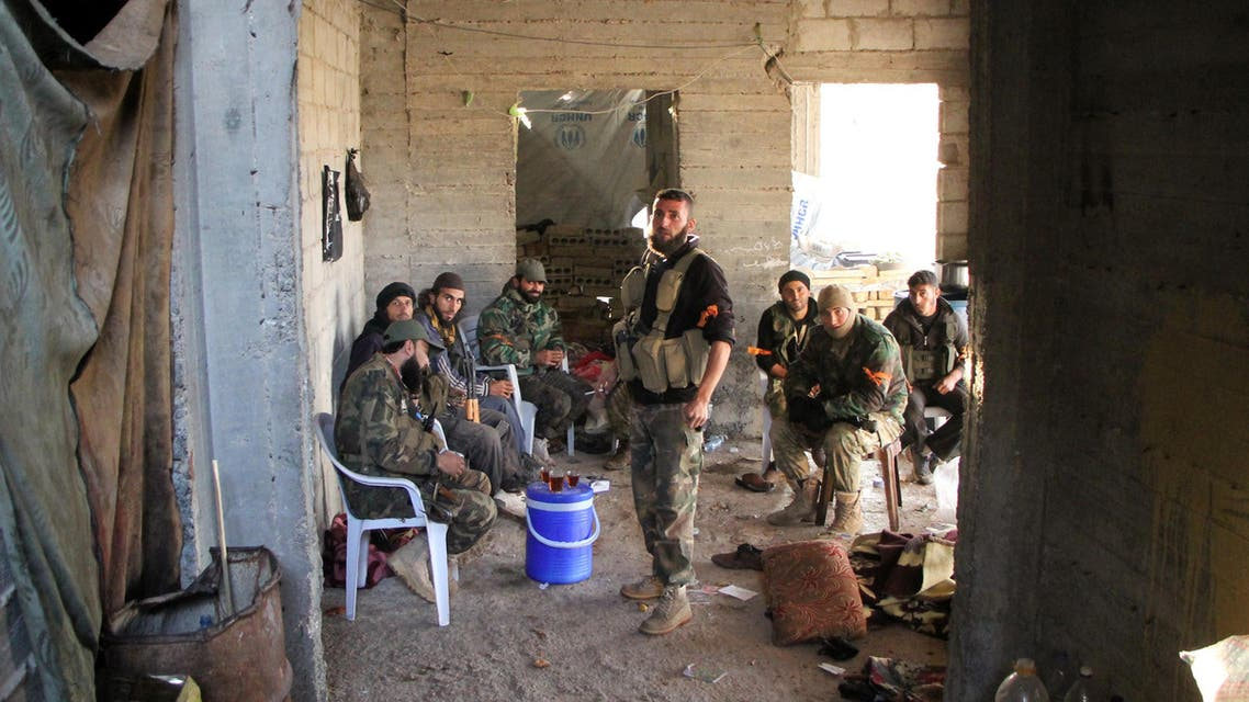 Rebel fighters from the Jaish al-Fatah (or Army of Conquest) brigades have a tea in a building under construction on October 29, 2016 in the neighbourhood of Dahiyet al-Assad, southwest of Aleppo, after they retook control of the area. Syrian rebels launched a major assault on October 28, 2016 aimed at breaking a months-long siege of opposition-held districts of Aleppo, as regime ally Russia held off on renewed air strikes. Control of the city, divided between the rebel-held east and the west in the hands of President Bashar al-Assad's forces, is key to securing northern Syria.  Omar haj kadour / AFP