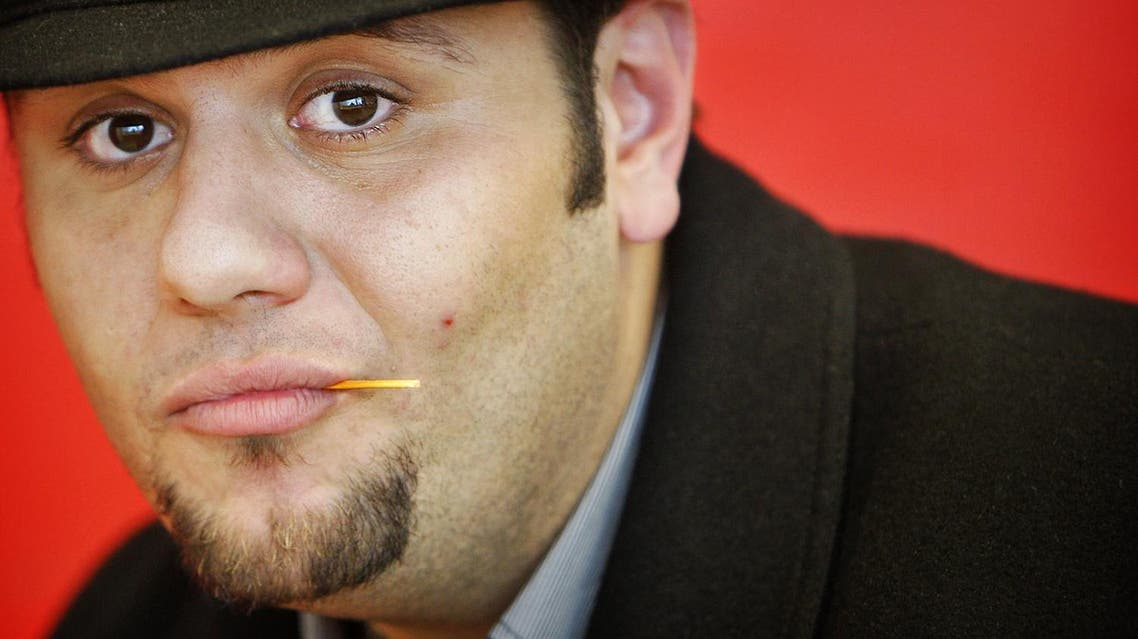 Arab American comedian Mo (Mohammed) Amer, one of the three members of Allah Made Me Funny poses during a workshop to students of the Islamic College in Amsterdam on April 3, 2008. ANP PHOTO/KOEN VAN WEEL netherlands out - belgium out Koen van Weel / ANP / AFP