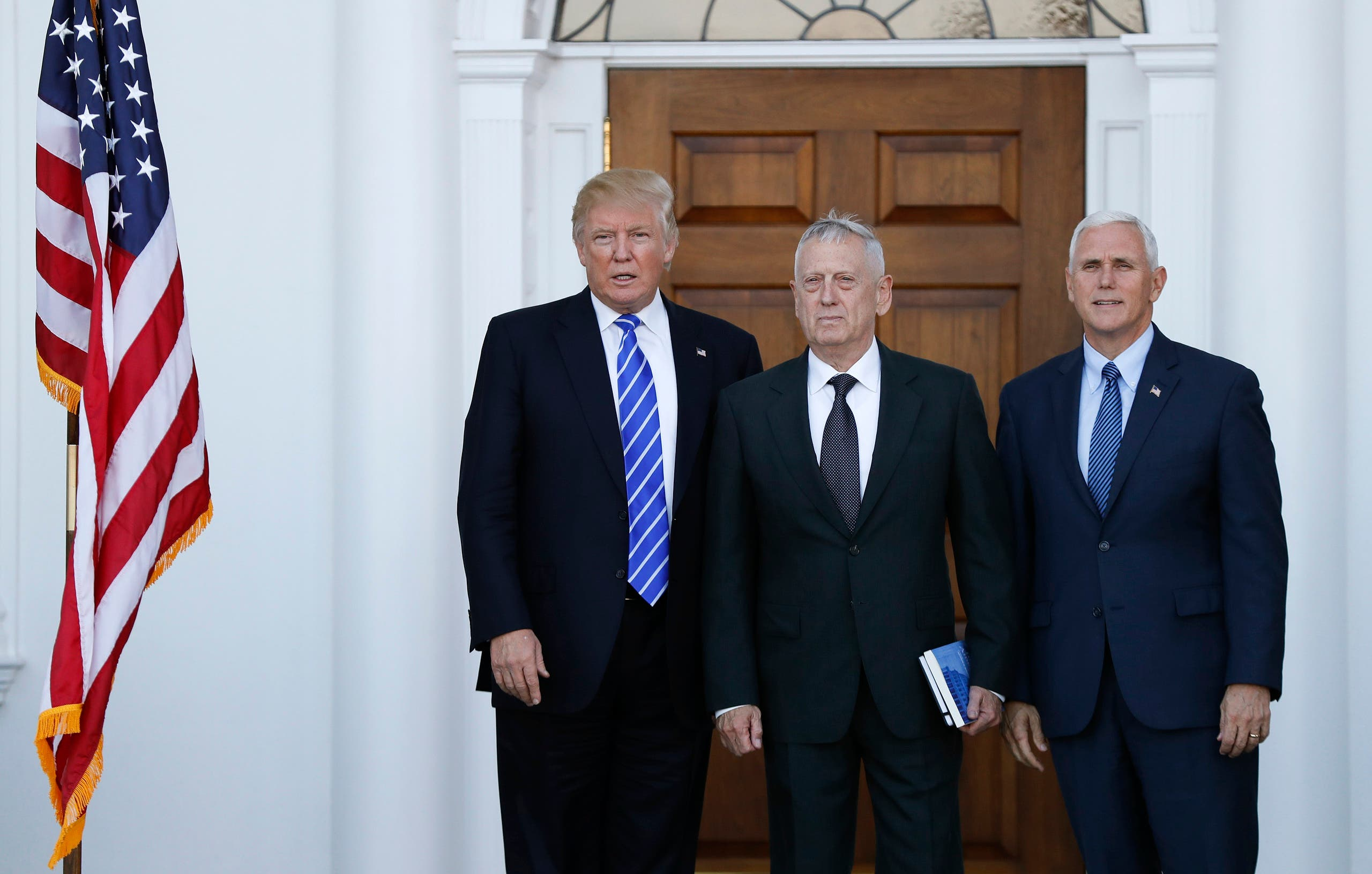 President-elect Donald Trump and Vice President-elect Mike Pence pose for photographes with retired Marine Corps Gen. James Mattis as he arrives at Trump National Golf Club Bedminster clubhouse in Bedminster, N.J., Saturday, Nov. 19, 2016. (AP)