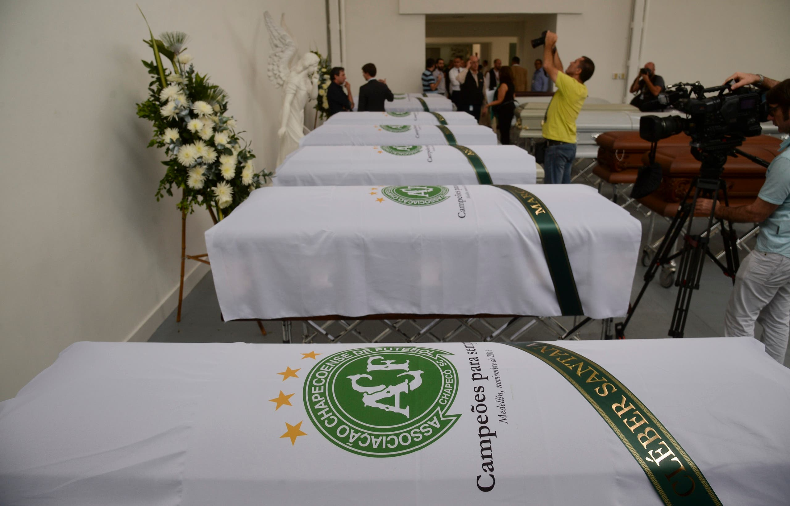 The coffin containing the remains of Brazilian football team Chapecoense Real's players Cleber Santana (foreground), killed in a plane crash in the Colombian mountains, is seen at the San Vicente mortuary in Medellin on December 1, 2016. The pilot of a charter plane carrying the Brazilian football team Chapecoense Real radioed frantically that he was out of fuel minutes before slamming into a hillside near Medellin with 77 people on board, an audio recording showed. Raul ARBOLEDA / AFP