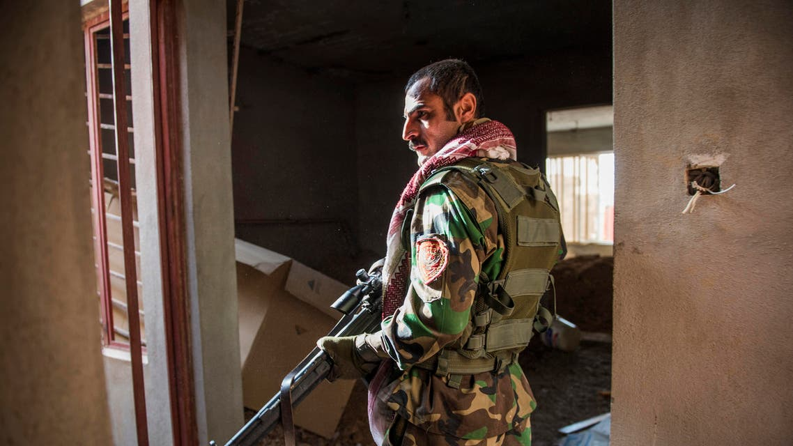 A Peshmerga fighter looks for hostiles as he and his team move between buildings in Bashiqa on November 9, 2016 Iraqi Kurdish forces have seized the town of Bashiqa near Mosul from the Islamic State group, an official said, as US-backed militia forces advanced on the jihadists' Syrian stronghold Raqa. Capturing Bashiqa would be a final step in securing the eastern approaches to Mosul, three weeks into an offensive by Iraqi forces to retake the country's second city.  Odd ANDERSEN / AFP