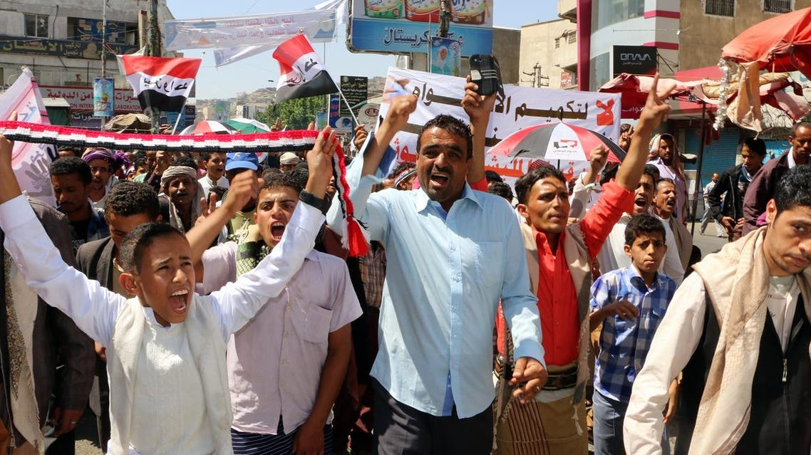 Yemenis take part in a demonstration following the Friday prayers in the second largest city of Taiz last year against Houthi militias. (AFP)