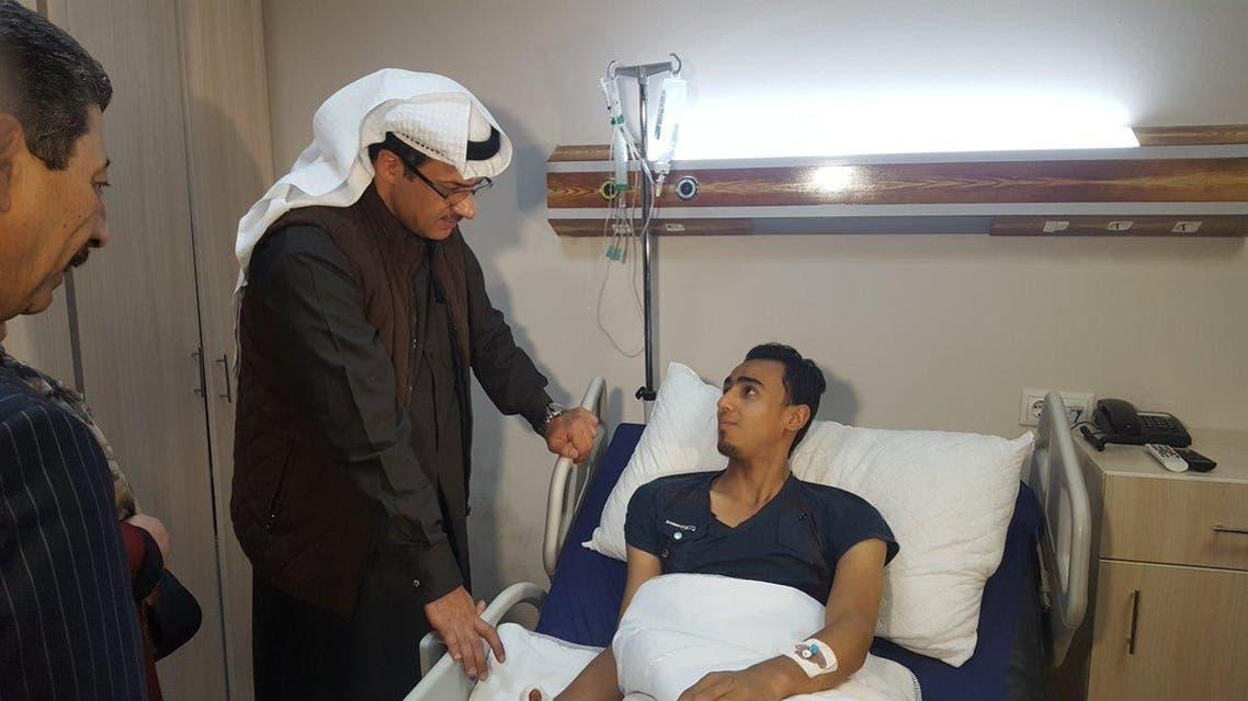 Kuwait's General Consul to Erbil Omar al-Kanderi with an Iraqi injured civilian. (KUNA)