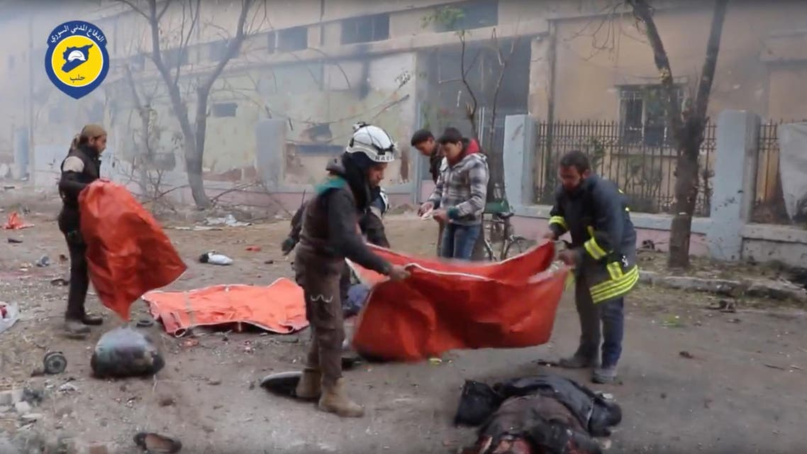 Rescue workers cover bodies scattered in the streets of rebel-held eastern Aleppo after artillery bombardment,reuters