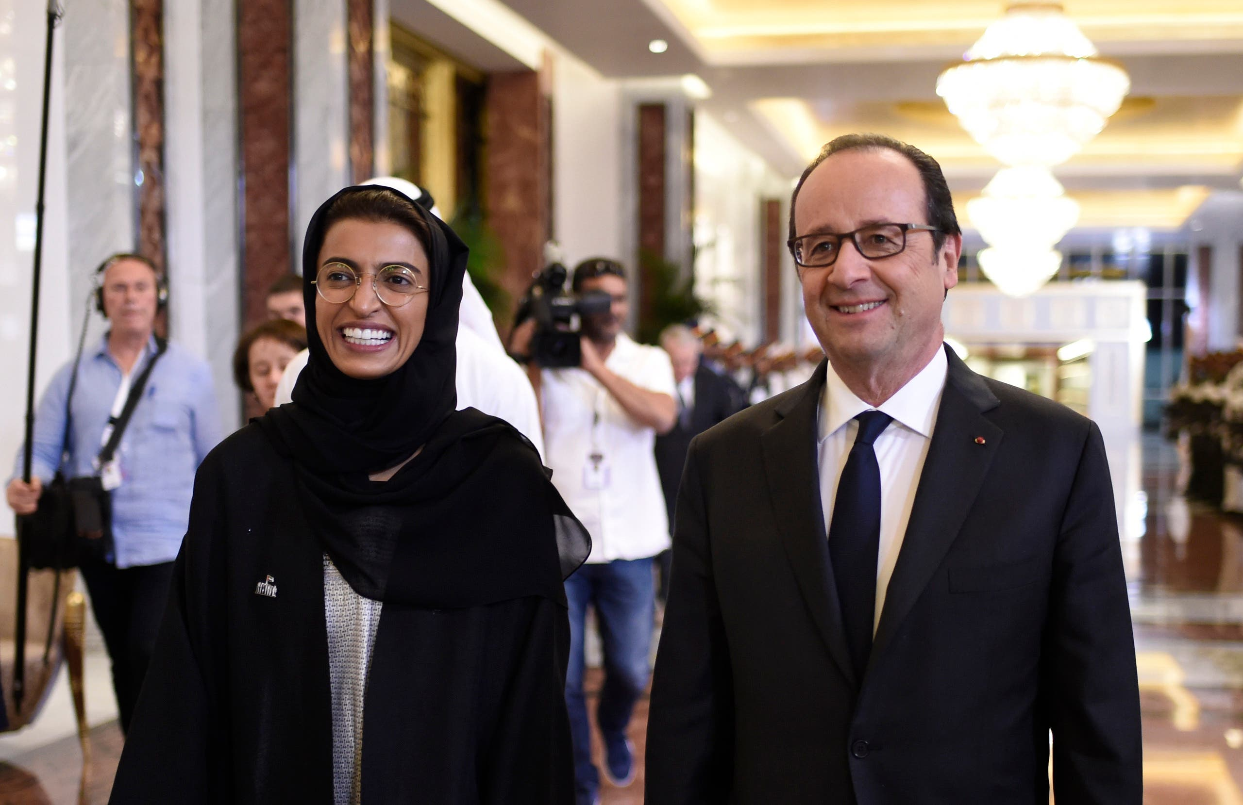 French President Francois Hollande (R) meets with Emirati State Minister to the United Arab Emirates' Federal National Council, Noura al-Kaabi, upon his arrival on December 2, 2016 in Abu Dhabi. afp