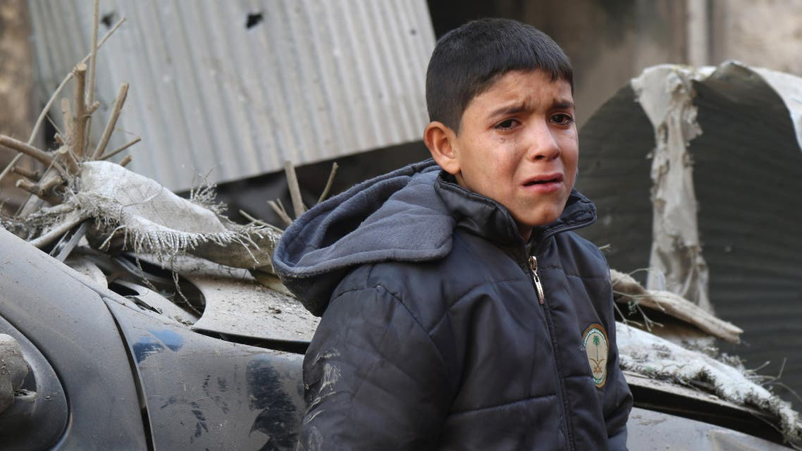 A Syrian boy cries as he stands next to a building hit by an air strike on the village of Maaret al-Numan, in the country's northern province of Idlib, on December 4, 2016. At least 46 people were killed in suspected Russian air strikes on several parts of the northwestern Syrian province of Idlib, the Syrian Observatory for Human Rights said. The Britain-based monitor said those killed in the strikes, on three locations in the province, were mostly civilians.  Mohamed al-Bakour / AFP