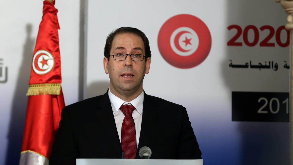 Tunisia's Prime Minister Youssef Chahed speaks during a news conference with his French counterpart Manuel Valls in Tunis Tunisia November 28, 2016 يوسف الشاهد تونس استثمار تونس 2020