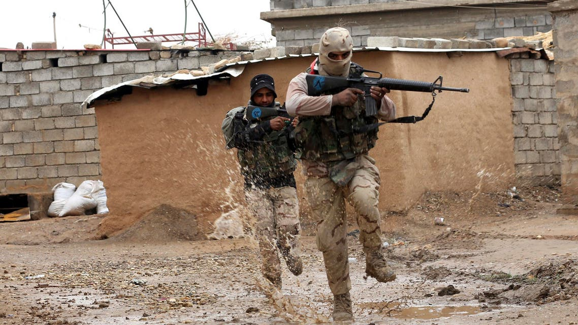 Iraqi Army soldiers secure streets in a recently liberated village occupied by Islamic State militants outside Mosul, Iraq, Thursday, Dec. 1, 2016. (AP Photo/Hadi Mizban)
