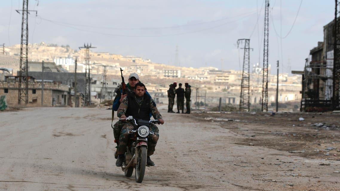 Syrian army soldiers patrol the east Aleppo neighborhood of Tariq al-Bab, Syria, Saturday, Dec. 3, 2016. Tariq al-Bab was captured by Syrian government forces on Friday. (AP