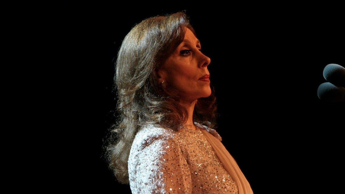 This picture released by the press office of Lebanese diva Fairuz, shows the diva performing during her concert at the ancient Odeon of Herodes Atticus late 07 July 2007 in the Greek capital Athens. Fairuz's soldout concert in the ancient amphitheatre by the Acropolis was attended by 5,000 people, some of whom flew in from neighbouring countries. AFP