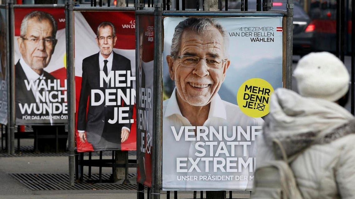 A woman passes posters of left-leaning presidential candidate Alexander van der Bellen in Vienna, Austria, Monday, Dec. 5, 2016 (Photo: AP/Ronald Zak)