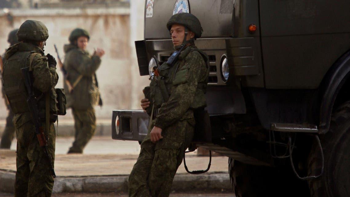 Russian soldiers stand near their vehicles in Aleppo Syria December 4, 2016 جنود روس في حلب سوريا جندي روسي روسيا قوات روسيا الجيش الروسي جيش روسيا