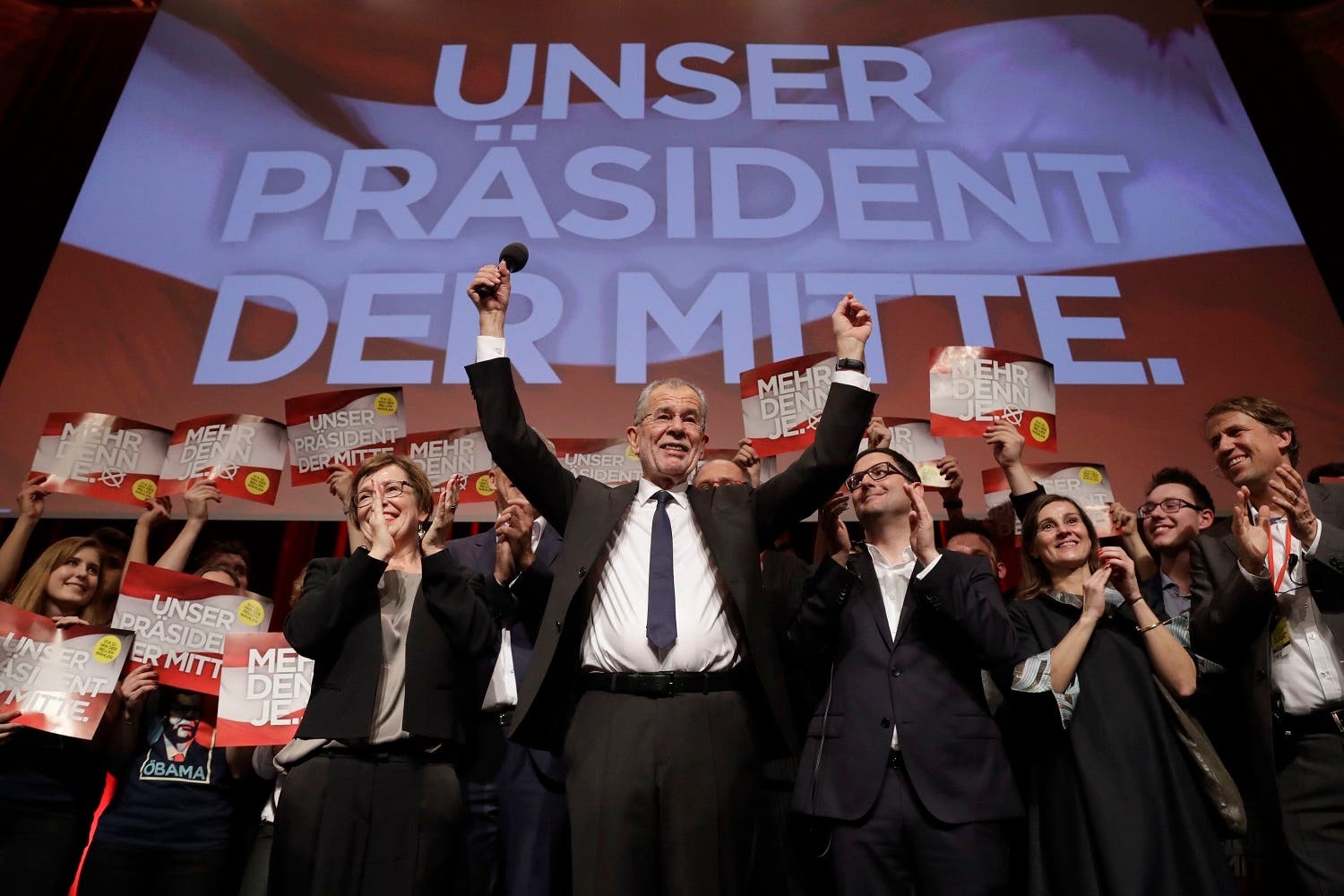 Presidential candidate Alexander Van der Bellen, a former leading member of the Greens Party, celebrates on the podium at a party of his supporters in Austria's capital Vienna Sunday, Dec. 4, 2016, after being declared the winner in the first round (Photo: AP/Matthias Schrader)