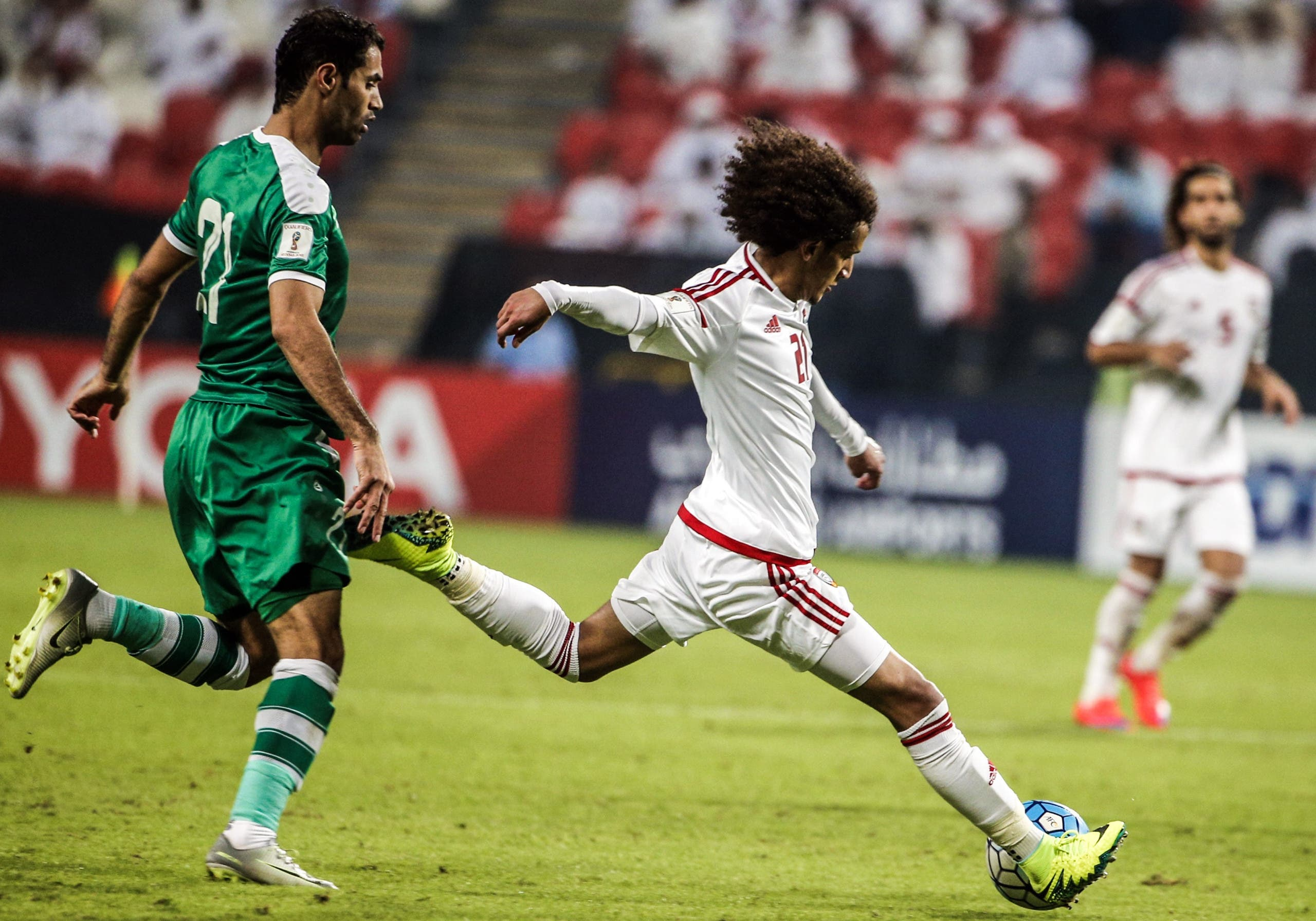 Iraqi's Saad Luaibi (L) vies for the ball with UAE's Omar Abdulrahman during the 2018 World Cup qualifying football match between Iraq and the United Arab Emirates at Sheikh Mohammed Bin Zayed stadium in Abu Dhabi on November 15, 2016.  Karim Sahib / AFP
