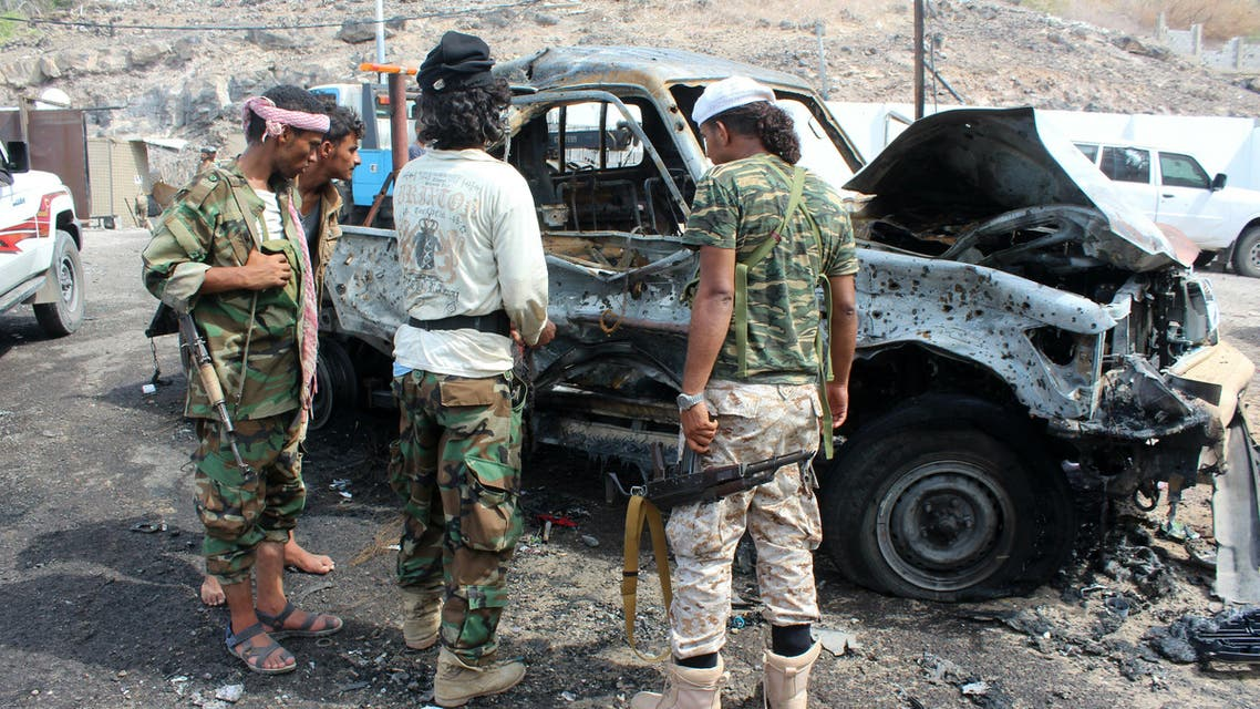 Yemeni loyalist forces gather at the scene of a suicide attack targeting the police chief in the base of the Saudi-backed government on April 28, 2016 in Yemen's second city Aden. AFP