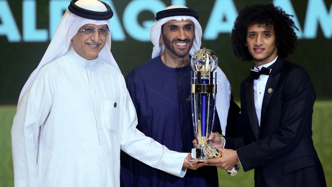 Shaikh Salman bin Ebrahim Al Khalifa (L), President of the Asian Football Confederation (AFC), and Sheikh Nahyan Bin Zayed Al Nahyan (C), Chairman of the Abu Dhabi Sports Council, present Omar Abdulrahman (R) with a trophy after being named the AFC Men's Footballer of the Year during the Asian Football Confederation's Annual Awards ceremony on December 1, 2016 in Abu Dhabi.  NEZAR BALOUT / AFP