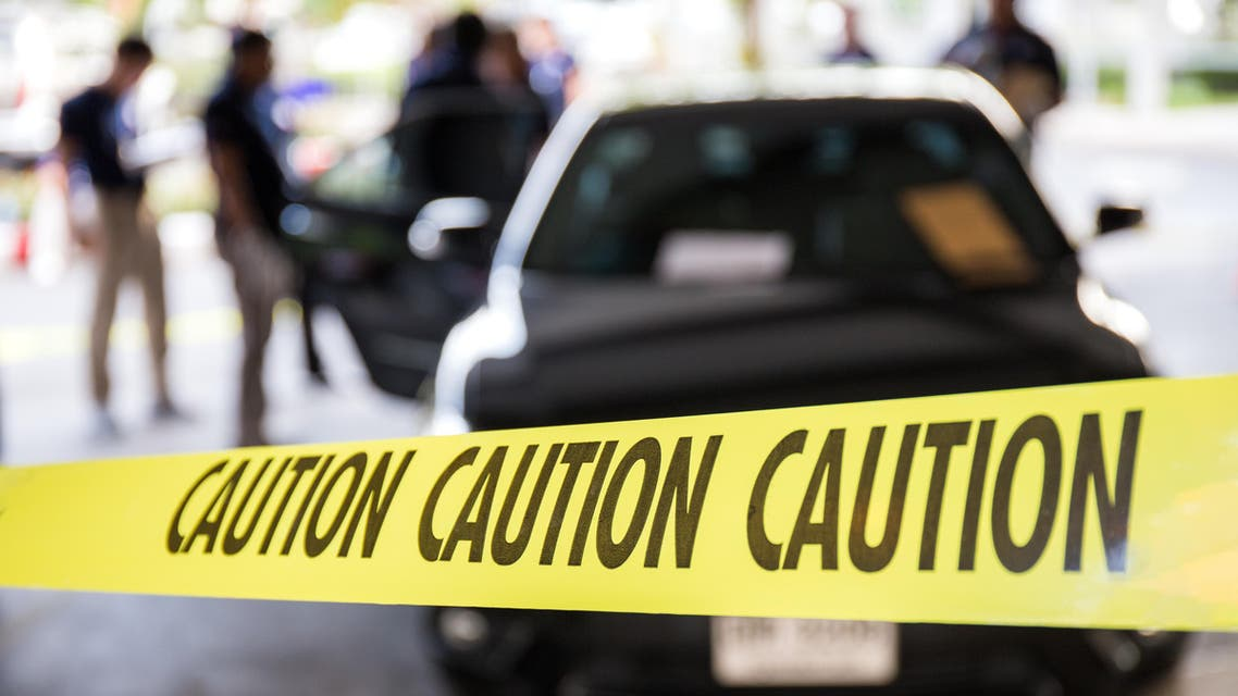 caution tape or police line protect vehicle in crime scene investigation training in academy with blurred law enforcement background. shutterstock