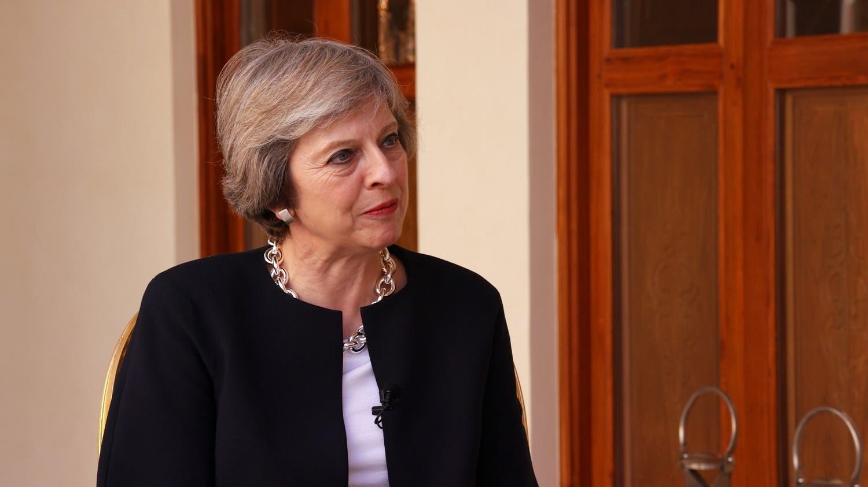 UK PM Theresa May talks to Turki al-Dakhil (Al Arabiya News)