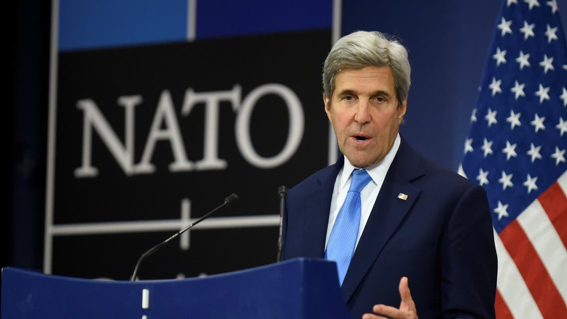 US Secretary of State John Kerry gestures as he give a press conference during a Foreign Affairs meeting at the NATO headquarters in Brussels on December 6, 2016. AFP