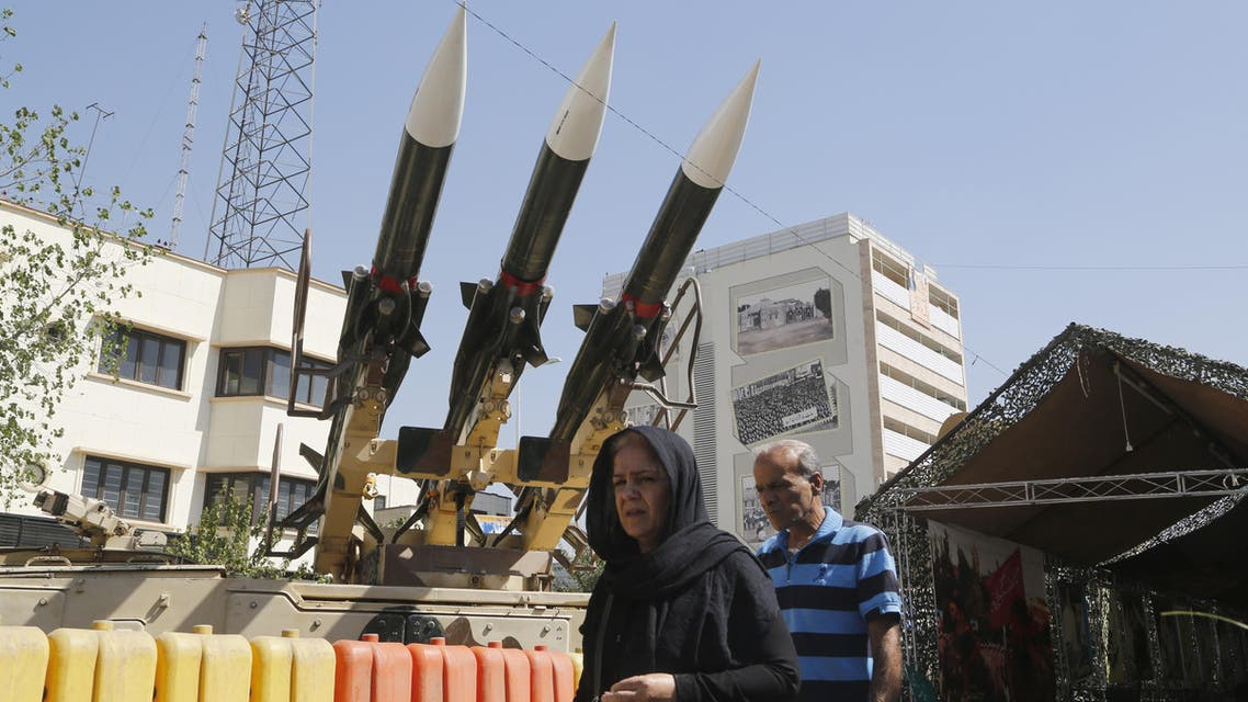 Iranians walk past Sam-6 missiles displayed in the street during a war exhibition to commemorate the 1980-88 Iran-Iraq war at Baharestan square, south of Tehran on September 26, 2016.  ATTA KENARE / AFP