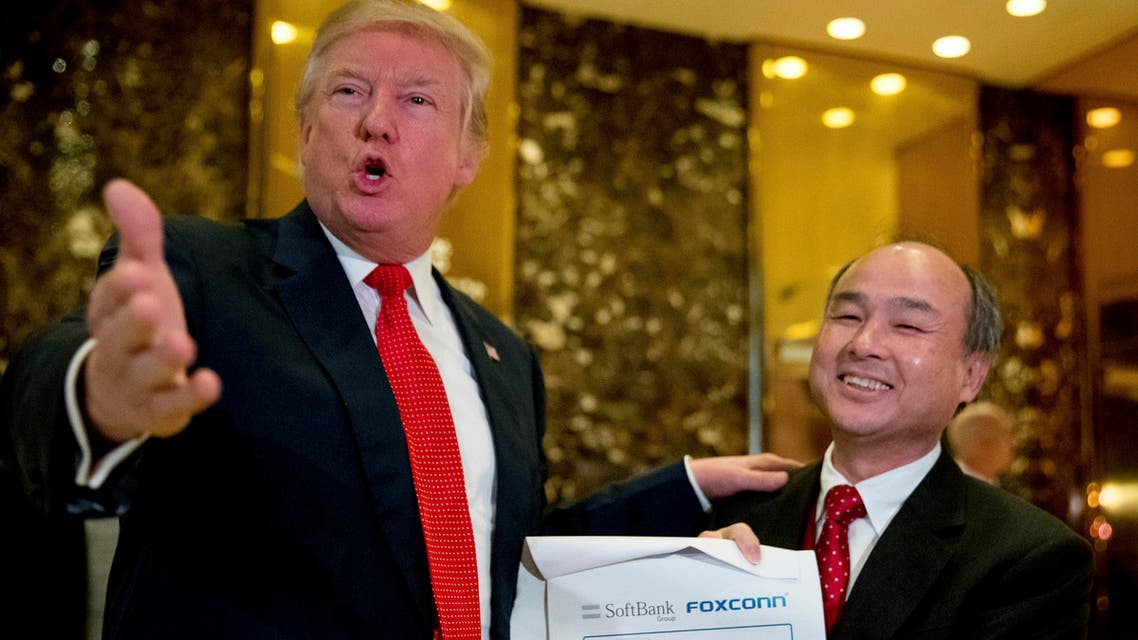President-elect Donald Trump, accompanied by SoftBank CEO Masayoshi Son, speaks to members of the media at Trump Tower in New York, on Tuesday, Dec. 6, 2016. (AP)