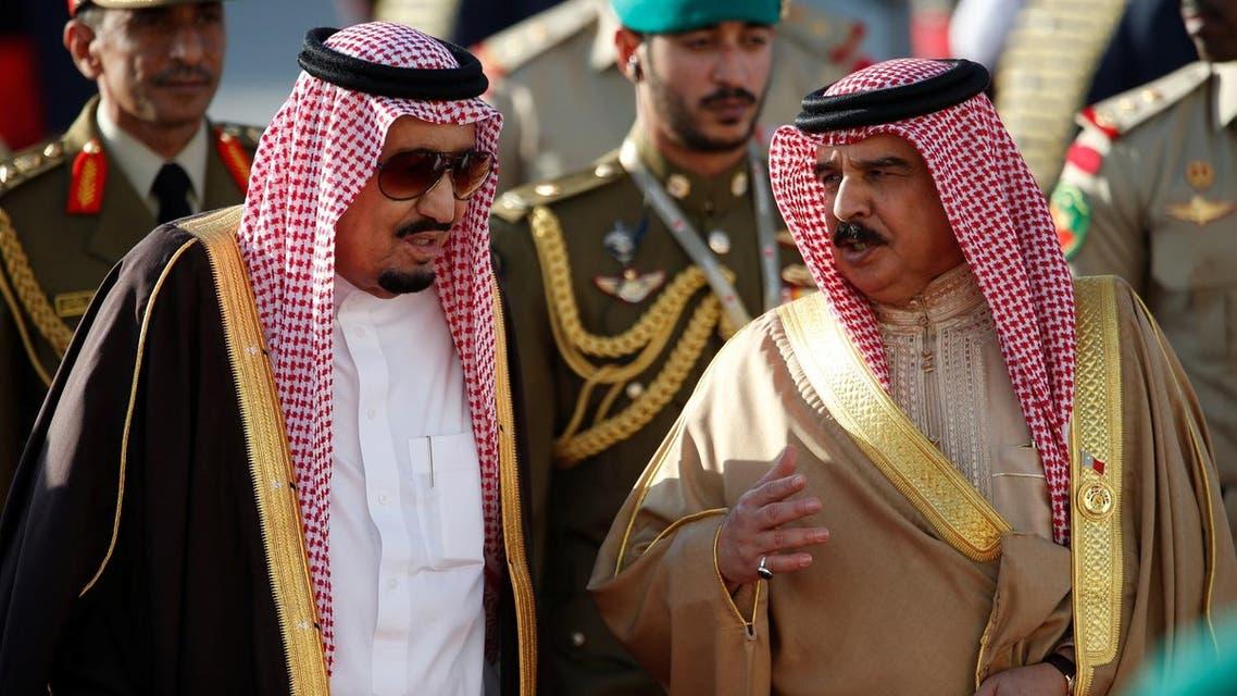 Saudi King Salman bin Abdulaziz Al-Saud is received by Bahraini King Hamad bin Isa Al Khalifa upon his arrives at Sakhir VIP airport to attend the GCC 37th Summit. (Reuters)