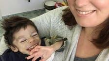 شاهد معجزة هذا الطفل المعاق بعد عامين مع سيدة أميركية
