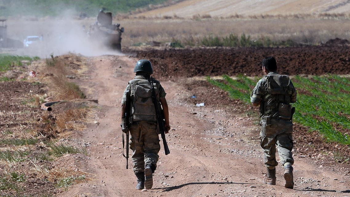 Turkish soldiers patrol near the border with Syria, ouside the village of Elbeyli, east of the town of Kilis, southeastern Turkey, Friday, July 24, 2015.