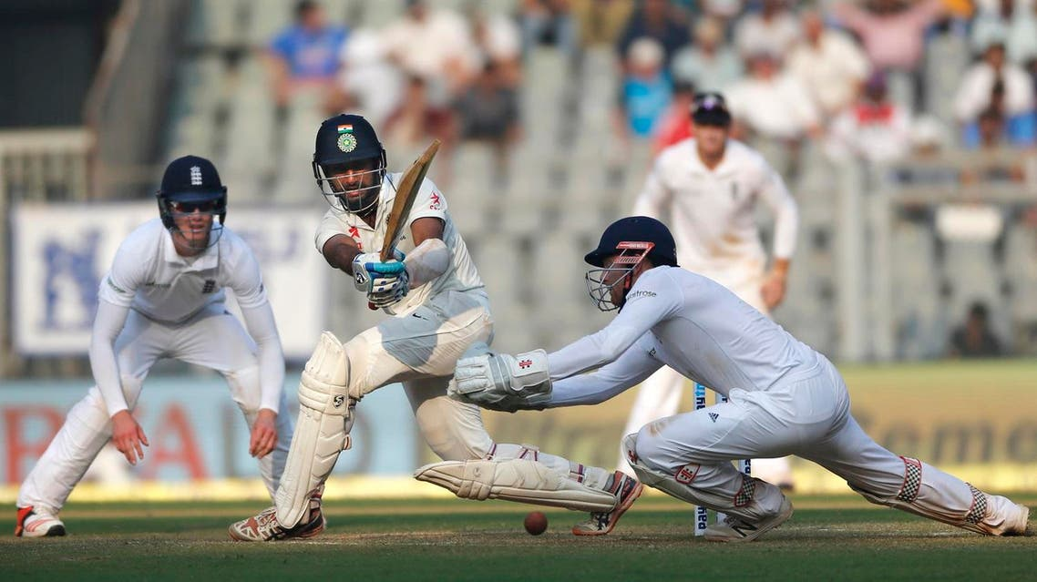Indian batsman Cheteshwar Pujara, second from left, bats on the second day of the fourth cricket test match between India and England in Mumbai, India, Friday, Dec. 9, 2016. (AP Photo/Rafiq Maqbool)