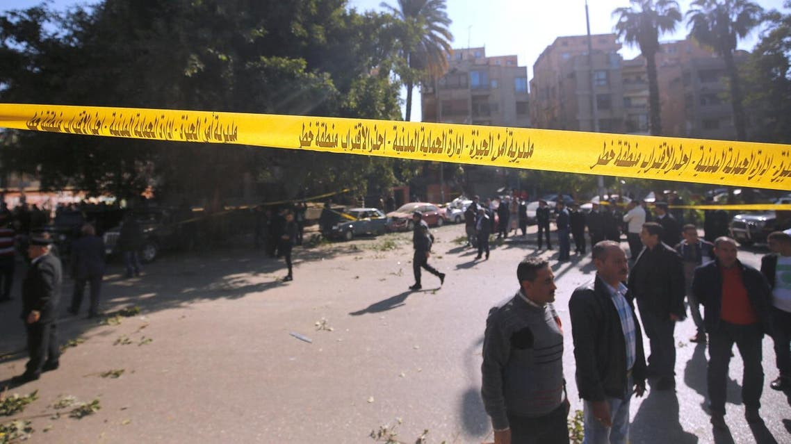 Security officials and investigators inspect the scene of a bomb blast in Giza Al Haram Street on the outskirts of Cairo. (Reuters)