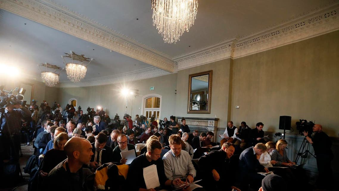 "Journalists wait for the World Anti-Doping Agency investigator Richard McLaren to speak at a press conference in London, Friday Dec. 9, 2016. A new report into systematic Russian doping details a wide-ranging ""institutional conspiracy"" that involved more than 1,000 athletes across more than 30 sports, including evidence corroborating large-scale sample swapping at the 2014 Sochi Winter Olympics. (AP Photo/Kirsty Wigglesworth)"