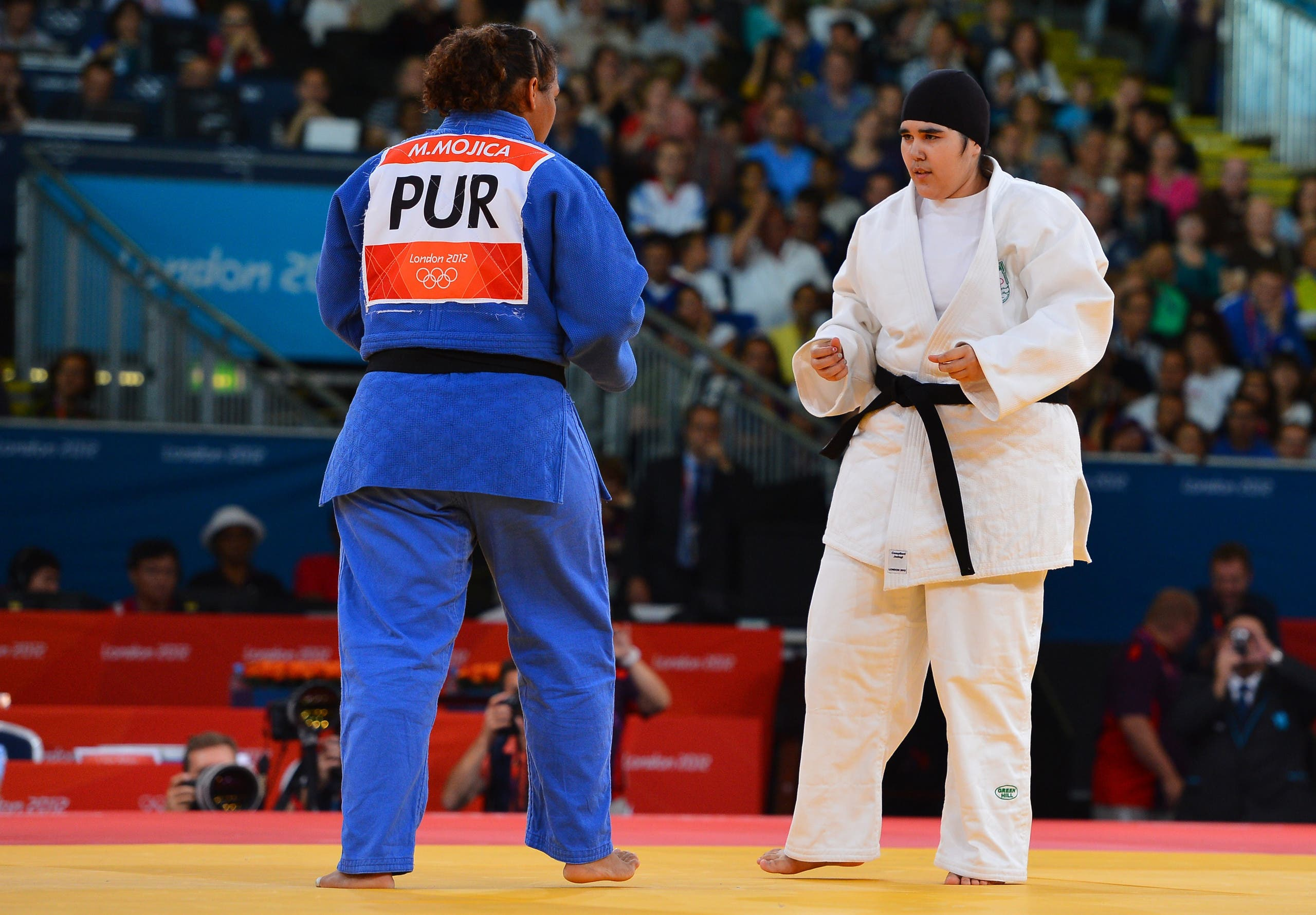 Saudi Arabia's Wojdan Shaherkani (white) competes with Puerto Rico's Melissa Mojica (blue) during their women's +78kg judo contest match of the London 2012 Olympic Games on August 3, 2012 at the ExCel arena in London. (AFP)