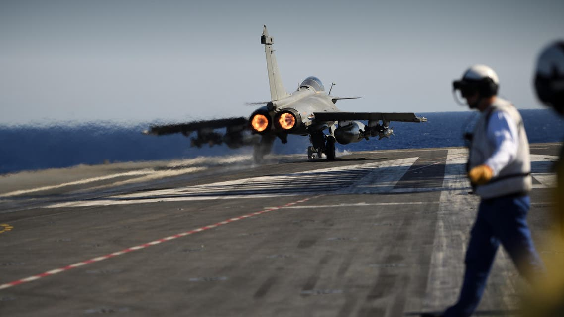 A Marine Rafale jet fighter lifts off from the French aircraft carrier Charles de Gaulle, in the Mediterranean Sea on october 2, 2016 as part of the Operation Arromanches