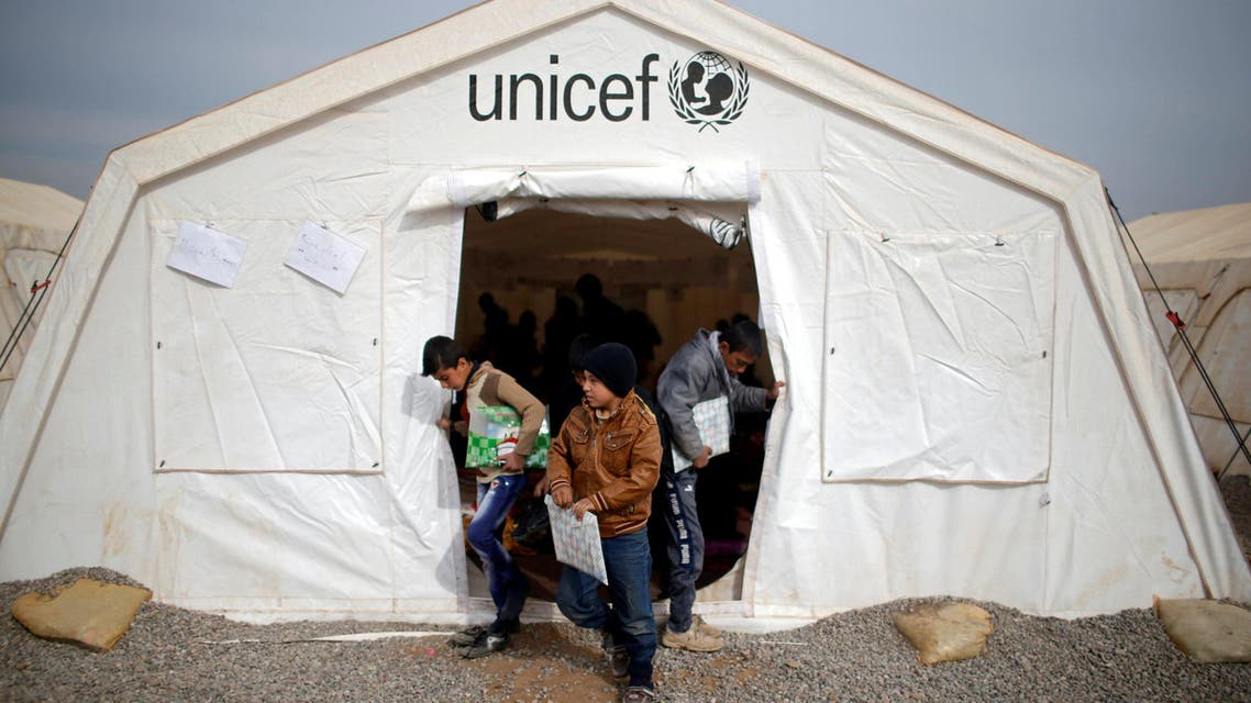 Displaced Iraqi boys leave a tent school set by United Nations Children's Fund (UNICEF) at Hassan Sham camp, east of Mosul, Iraq December 8, 2016