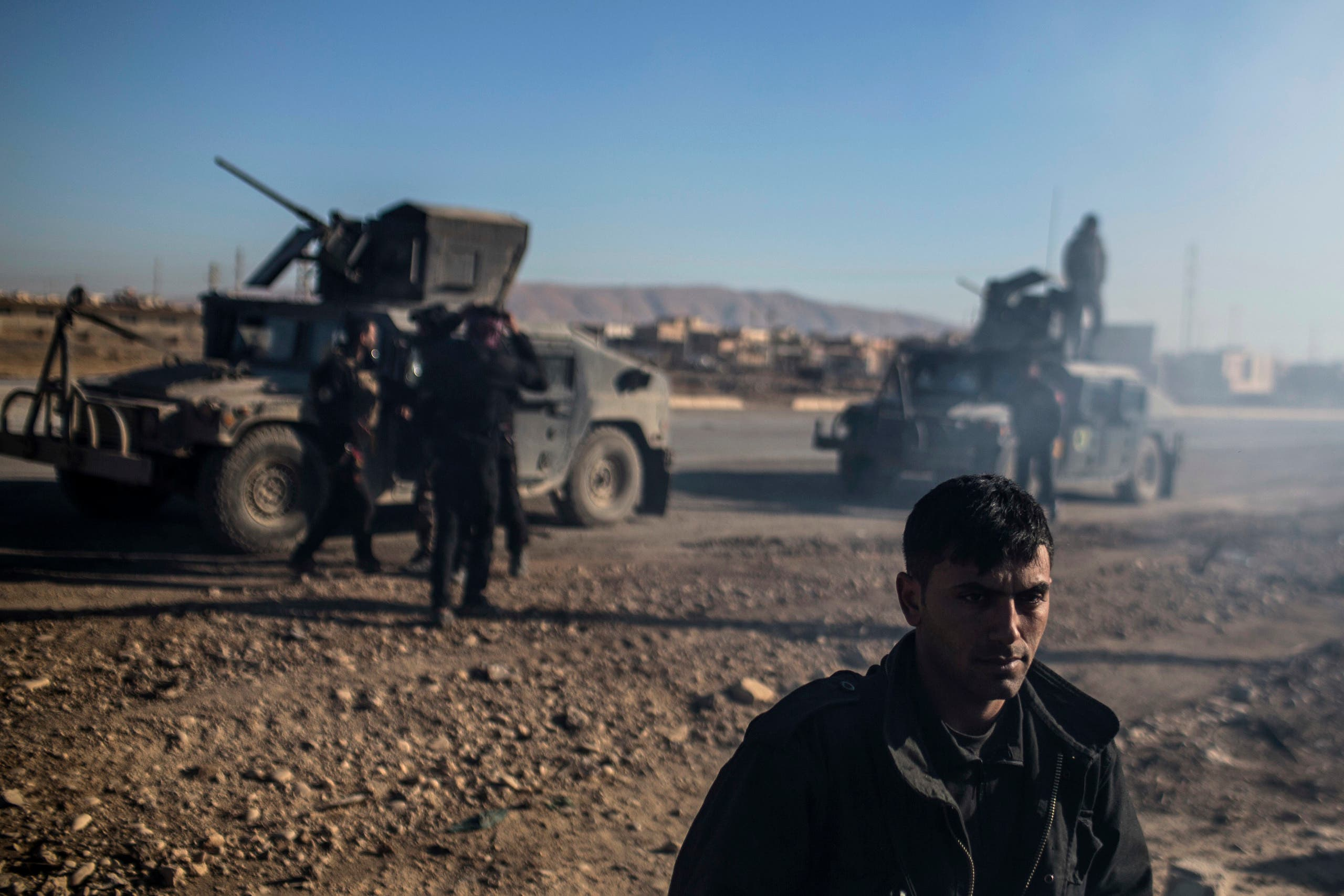 An Iraqi Special Forces member stands near the main road from Erbil to Mosul with his unit, in the village of Bartala, Iraq, Wednesday, Dec. 7, 2016. (AP)