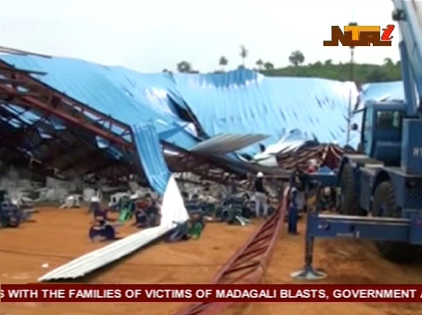 People stand near the remains of a church which collapsed during a service in the southern city of Uyo in Akwa Ibom state, Nigeria in this still image from video. (Reuters)