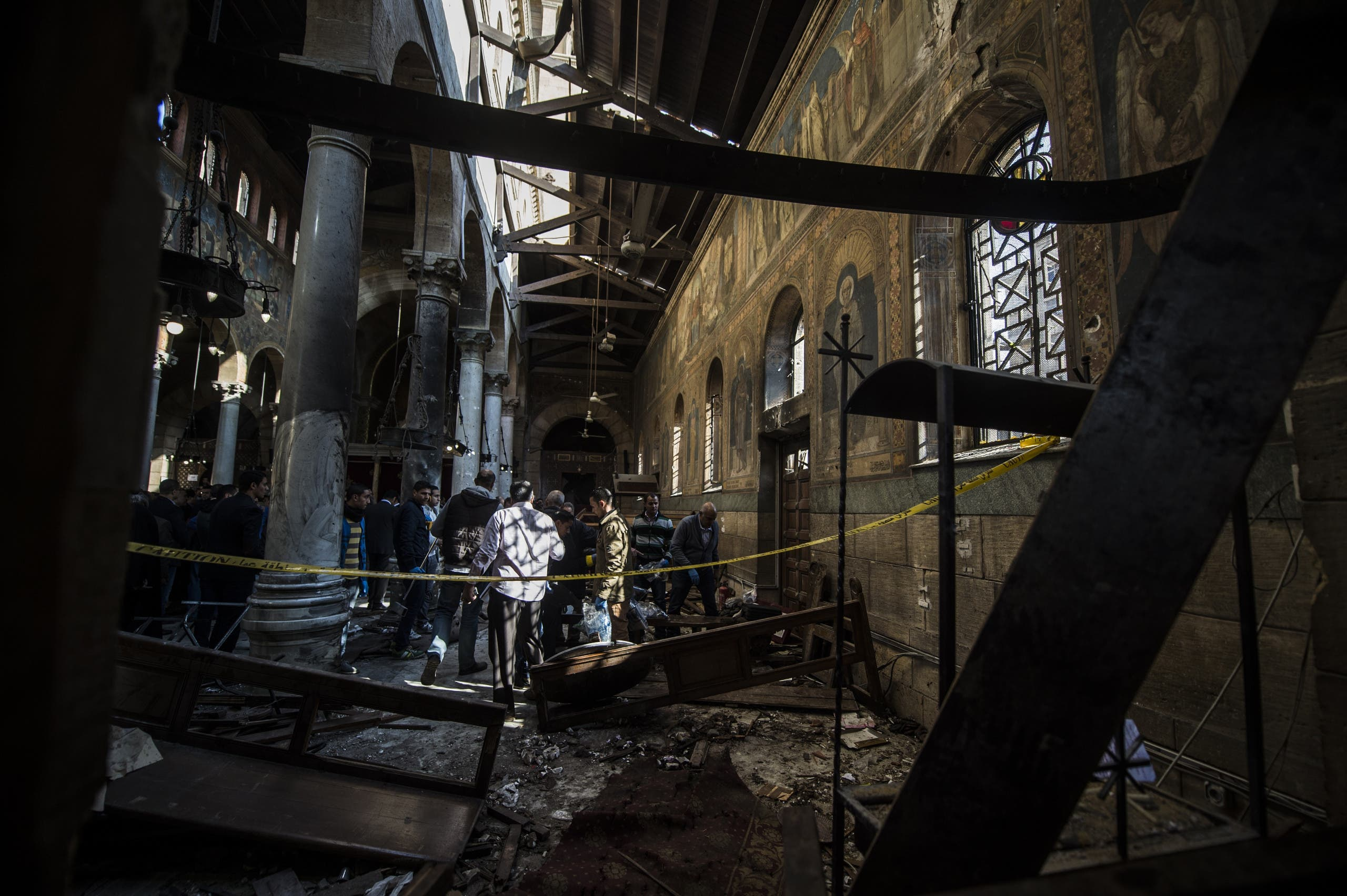 Egyptian security forces inspect the scene of a bomb explosion inside the Saint Peter and Saint Paul Coptic Orthodox Church on December 11, 2016, in Cairo's Abbasiya neighbourhood.